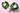Zwei Kokosnusshälften liegen auf großen grünen Palmblättern und Schale mit weißem Kokosnussfleisch auf rosa Untergrund