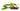 Einige dunkelbraune Jojobafrüchte mit einem Jojobastrauch mit grünen Blättern und gelben Blüten auf weißem Hintergrund